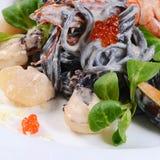 Black spaghetti with seafood Stock Photos