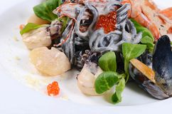Black spaghetti with seafood Stock Images