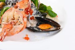 Black spaghetti with seafood Stock Image