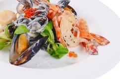 The black spaghetti with seafood closeup Stock Photos