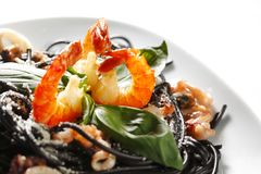 Black spaghetti with seafood Royalty Free Stock Images