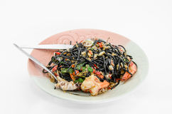 Black spaghetti with seafood. On white background Royalty Free Stock Photo