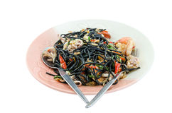 Black spaghetti with seafood. On white background Royalty Free Stock Photography