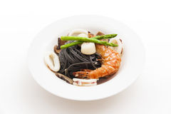 Black spaghetti with seafood on white background Royalty Free Stock Photo