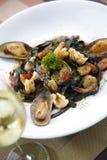 Black spaghetti and seafood Stock Image