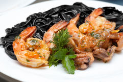 Black spaghetti with shrimps Royalty Free Stock Image