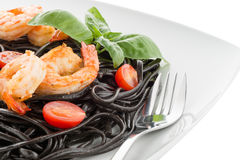 Black spaghetti with shrimps Stock Image