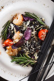 Black spaghetti with shrimps and vegetables Royalty Free Stock Images