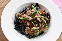 Black spaghetti stir Stock Image