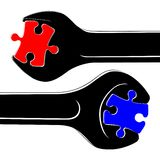 Black spanners, red and blue puzzles Stock Photo