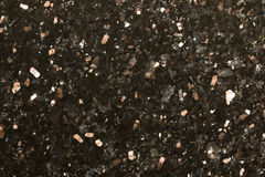 Black sparkle polished granite abstract background Stock Photo