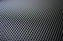 Black Speaker Grille. Black speaker grill texture with medium holes Royalty Free Stock Photo
