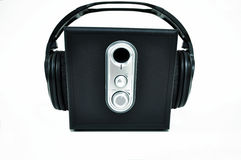 Black speaker with headphones. Black and silver stereo speaker with adjustable sound and headphones Stock Photos