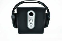 Black speaker with headphones Stock Photos