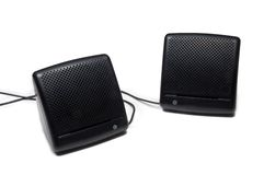 Black speakers. Closeup of two black speakers on white background Stock Photography