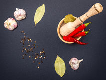 Black spicy background. With mortar and pepper Royalty Free Stock Photos