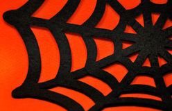 Black spider web on an orange background Royalty Free Stock Photos