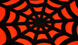Black spider web on an orange background Stock Photos