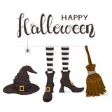 Text Happy Halloween with witches legs with hat and broom Royalty Free Stock Photography