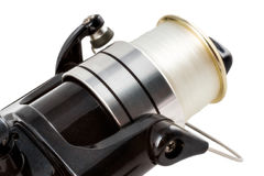 Black spinning reel. Close-up view of the black spinning reel Royalty Free Stock Image