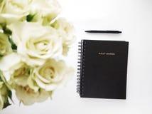 Black Spiral Book on White Surface stock photos