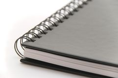 Black spiral notebook on white background Stock Photography