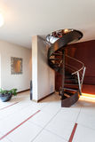 Black spiral stairs. Black original spiral stairs in a fair classy room Stock Photos