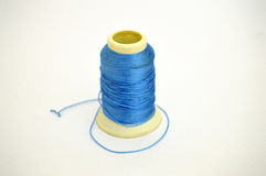 Black spool thread and needle pictures for tailor and tailor sites Royalty Free Stock Photo