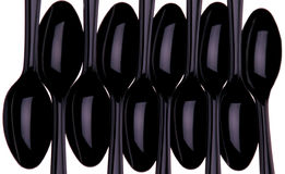 Black Spoons. Tten Black Plastic spoons isolated over white stock image