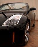 Black sport car. Headlight detail and alloy wheel Stock Photo
