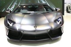 Black sport car on fair stand Stock Photos