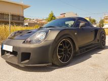 Black sport car parked on the road.  Royalty Free Stock Photo