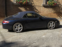 Black sport car. ROME, ITALY - CIRCA JULY 2016: black sport cabrio car parked in a street of the city centre Royalty Free Stock Photography