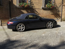 Black sport car. ROME, ITALY - CIRCA JULY 2016: black sport cabrio car parked in a street of the city centre Stock Photo