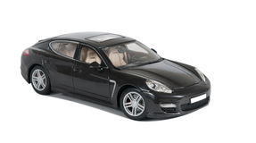 Black sport car Turbo. Collectible toy car side view on a white background Stock Image