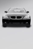 Black sports car. Black bmw on a grey background Royalty Free Stock Images