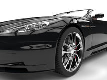Black sports car - headlight and tire closeup Royalty Free Stock Images