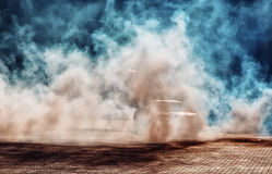 Black sports car smokes wheels Royalty Free Stock Photography