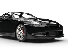 Black Sports Car on White Background - Front Closeup Royalty Free Stock Image