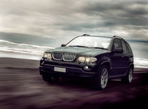 Black Sports Wagon on Beach Royalty Free Stock Images