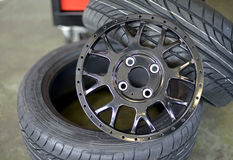 Black sports wheel rim. With tires Stock Images