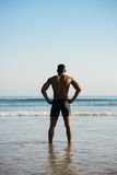 Black sportsman ready for swimming into the sea Stock Image