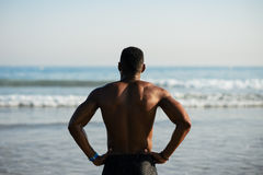 Black sportsman ready for swimming into the sea Stock Photo