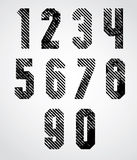 Black spotted numbers with diagonal lines on white background. Royalty Free Stock Photography