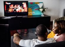 Black spouse watching movie enjoy precious time together stock photos