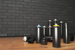 Black spray paint bottle Stock Images