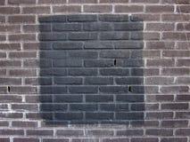Black square on a brick stone wall. A black square on a brick stone wall i.m. Malevich Stock Images