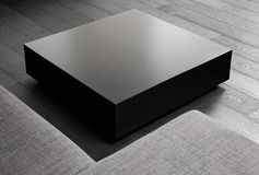 Black square coffee-table. Modern interior detail Royalty Free Stock Image