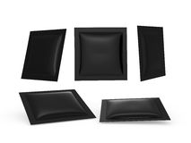 Black square heat sealed packet with clipping path. Black square heat sealed packet  with clipping path. Packing  or wrapper for sweet, snack, milk bar, coffee Royalty Free Stock Photography