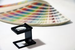 Black square Magnifying glass and Rainbow Sample Colors Palette Catalog. stock photos